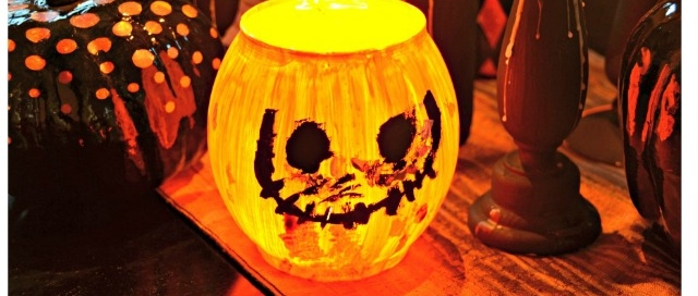 Turn an ordinary vase into a Jack-O-Lantern - great craft to make with the kids!