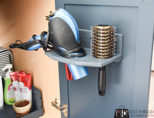 In-cupboard hair dryer holder
