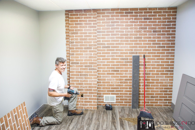 Details Renovations installing faux brick wall